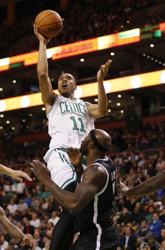 Oct 23, 2013; Boston, MA, USA; Boston Celtics shooting guard Courtney Lee (11) shoots against Brooklyn Nets power forward Reggie Evans (30) during the second half at TD Garden. The Celtics defeated the Brooklyn Nets 101-97. Mandatory Credit: David Butler II-USA TODAY Sports