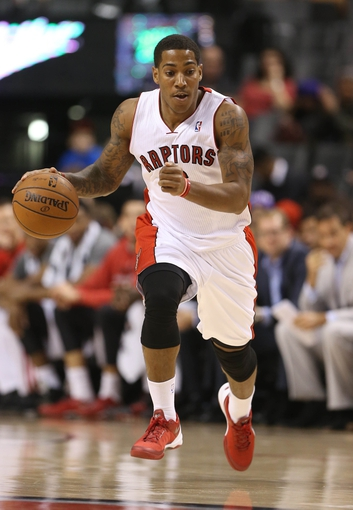 Oct 23, 2013; Toronto, Ontario, CAN; Toronto Raptors point guard Carlos Morais (6) brings the ball up the court against the Memphis Grizzlies at Air Canada Centre. The Raptors beat the Grizzlies 108-72. Mandatory Credit: Tom Szczerbowski-USA TODAY Sports