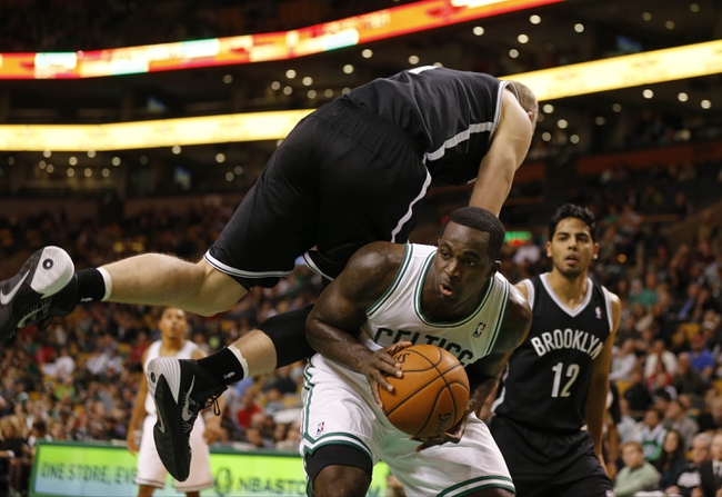 Oct 23, 2013; Boston, MA, USA; Boston Celtics power forward Brandon Bass (30) is fouled by Brooklyn Nets power forward Mason Plumlee (1) during the second half at TD Garden. The Celtics defeated the Brooklyn Nets 101-97. Mandatory Credit: David Butler II-USA TODAY Sports