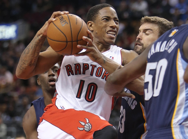 Oct 23, 2013; Toronto, Ontario, CAN; Toronto Raptors guard DeMar DeRozan (10) drives to the basket against Memphis Grizzlies center Marc Gasol (33) at Air Canada Centre. The Raptors beat the Grizzlies 108-72. Mandatory Credit: Tom Szczerbowski-USA TODAY Sports