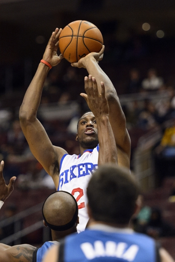 Oct 23, 2013; Philadelphia, PA, USA; Philadelphia 76ers forward Thaddeus Young (21) shoots a jump shot over the defense of Minnesota Timberwolves forward Dante Cunningham (33) during the third quarter at Wells Fargo Center. The Timberwolves defeated the Sixers 125-102. Mandatory Credit: Howard Smith-USA TODAY Sports