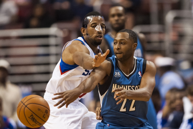 Oct 23, 2013; Philadelphia, PA, USA; Minnesota Timberwolves guard A.J. Price (22) passes the ball as Philadelphia 76ers guard Darius Morris (7) defends during the third quarter at Wells Fargo Center. The Timberwolves defeated the Sixers 125-102. Mandatory Credit: Howard Smith-USA TODAY Sports