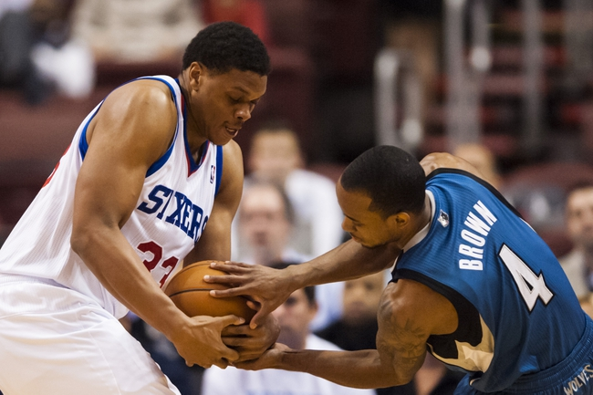 Oct 23, 2013; Philadelphia, PA, USA; Minnesota Timberwolves guard Lorenzo Brown (4) tries to steal the ball from Philadelphia 76ers center Daniel Orton (33) during the fourth quarter at Wells Fargo Center. The Timberwolves defeated the Sixers 125-102. Mandatory Credit: Howard Smith-USA TODAY Sports