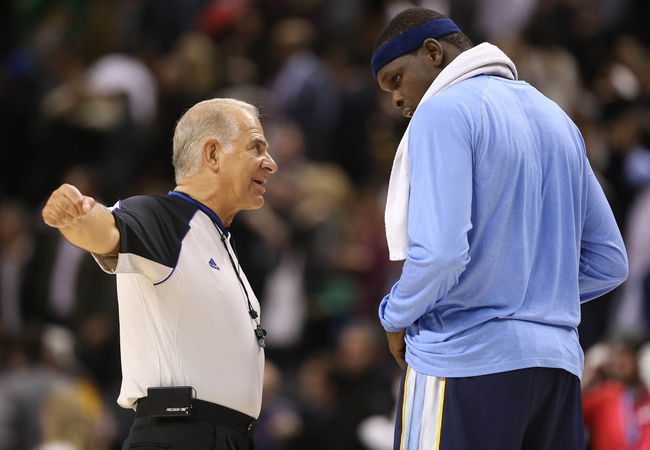 Oct 23, 2013; Toronto, Ontario, CAN; Referee Bennett Salvatore (15) speaks to Memphis Grizzlies forward Zach Randolph (50) after ejecting him for a flagrant foul on Toronto Raptors center Jonas Valanciunas (not pictured) at Air Canada Centre. The Raptors beat the Grizzlies 108-72. Mandatory Credit: Tom Szczerbowski-USA TODAY Sports