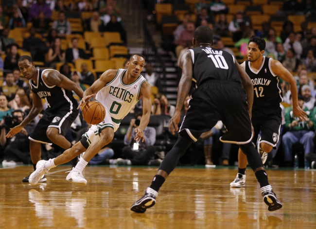 Oct 23, 2013; Boston, MA, USA; Boston Celtics point guard Avery Bradley (0) drives the ball against Brooklyn Nets point guard Tyshawn Taylor (10) during the second half at TD Garden. The Celtics defeated the Brooklyn Nets 101-97. Mandatory Credit: David Butler II-USA TODAY Sports