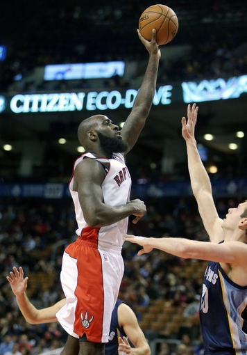 Oct 23, 2013; Toronto, Ontario, CAN; Toronto Raptors forward Quincy Acy (4) shoots against the Memphis Grizzlies at Air Canada Centre. The Raptors beat the Grizzlies 108-72. Mandatory Credit: Tom Szczerbowski-USA TODAY Sports