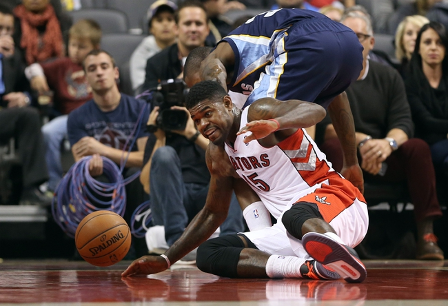 Oct 23, 2013; Toronto, Ontario, CAN; Toronto Raptors center Amir Johnson (15) battles for control of the ball under his basket against the Memphis Grizzlies at Air Canada Centre. The Raptors beat the Grizzlies 108-72. Mandatory Credit: Tom Szczerbowski-USA TODAY Sports