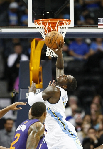 Oct 23, 2013; Denver, CO, USA; Denver Nuggets power forward J.J. Hickson (7) is fouled in the second quarter against the Phoenix Suns at the Pepsi Center. Mandatory Credit: Isaiah J. Downing-USA TODAY Sports