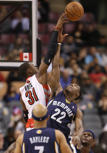 Oct 23, 2013; Toronto, Ontario, CAN; Toronto Raptors guard Terrence Ross (31) wins a tip-off against Memphis Grizzlies guard Jamaal Franklin (22) at Air Canada Centre. The Raptors beat the Grizzlies 108-72. Mandatory Credit: Tom Szczerbowski-USA TODAY Sports