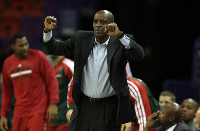 Oct 23, 2013; Green Bay, WI, USA; Milwaukee Bucks head coach Larry Drew signals to his team as they play the New York Knicks at the Resch Center in Green Bay. The  Milwaukee Bucks defeated the New York Knicks 105-95. Mandatory Credit: Mary Langenfeld-USA TODAY Sports