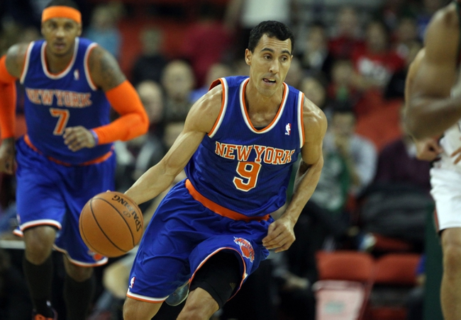Oct 23, 2013; Green Bay, WI, USA; New York Knicks guard Pablo Prigioni (9) moves the ball up the floor as his team plays the Milwaukee Bucks at the Resch Center in Green Bay.  The  Milwaukee Bucks defeated the New York Knicks 105-95.  Mandatory Credit: Mary Langenfeld-USA TODAY Sports