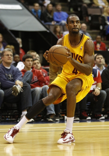 Oct 23, 2013; Cincinnati, OH, USA; Cleveland Cavaliers guard Elliot Williams (4) looks for a shot against the Washington Wizards at US Bank Arena. Mandatory Credit: David Kohl-USA TODAY Sports