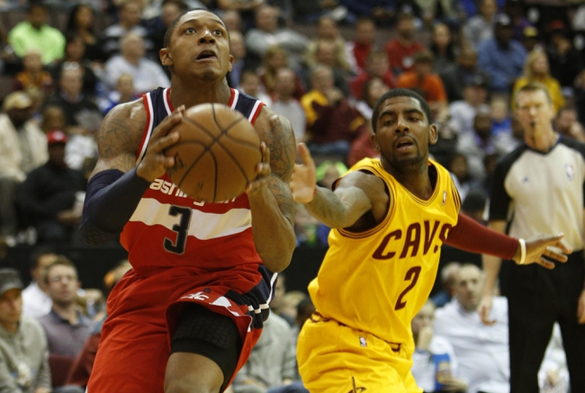 Oct 23, 2013; Cincinnati, OH, USA; Washington Wizards guard Bradley Beal (3) looks to shoot against Cleveland Cavaliers guard Kyrie Irving (2) at US Bank Arena. Mandatory Credit: David Kohl-USA TODAY Sports