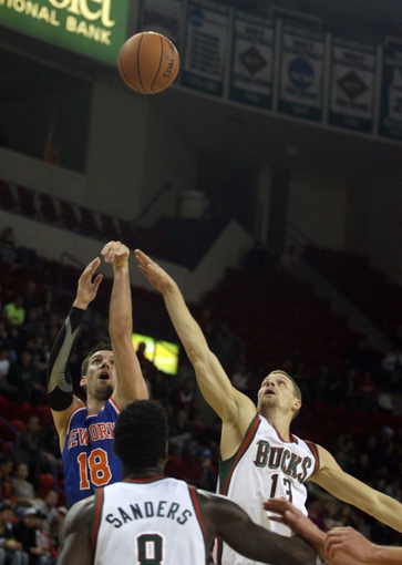 Oct 23, 2013; Green Bay, WI, USA; New York Knicks guard Beno Udrih (18) attempts a basket as Milwaukee Bucks guard Luke Ridnour (13) defends at the Resch Center in Green Bay.  The Milwaukee Bucks defeated the New York Knicks 105-95. Mandatory Credit: Mary Langenfeld-USA TODAY SportsLangenfeld-USA TODAY SportsLangenfeld-USA TODAY Sports