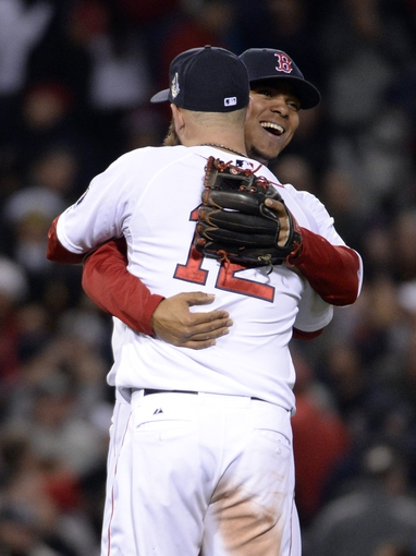 Oct 23, 2013; Boston, MA, USA; Boston Red Sox players Mike Napoli (12) and Xander Bogaerts celebrate after game one of the MLB baseball World Series against the St. Louis Cardinals at Fenway Park. Mandatory Credit: Robert Deutsch-USA TODAY Sports
