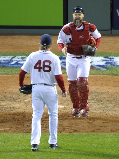 Oct 23, 2013; Boston, MA, USA; Boston Red Sox starting pitcher Ryan Dempster (left) celebrates with catcher David Ross after game one of the MLB baseball World Series against the St. Louis Cardinals at Fenway Park. Mandatory Credit: Bob DeChiara-USA TODAY Sports