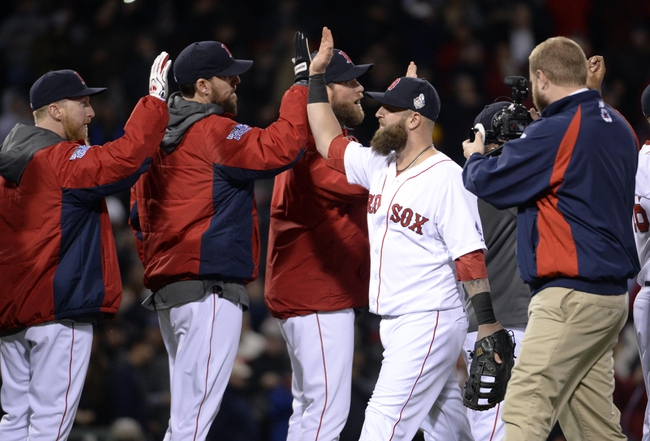 Oct 23, 2013; Boston, MA, USA; Boston Red Sox first baseman Mike Napoli (right) celebrates with teammates after game one of the MLB baseball World Series against the St. Louis Cardinals at Fenway Park. Mandatory Credit: Robert Deutsch-USA TODAY Sports