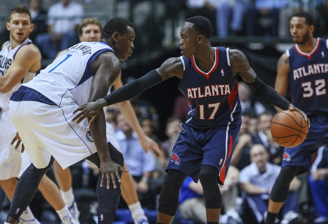 Oct 23, 2013; Dallas, TX, USA; Atlanta Hawks point guard Dennis Schroder (17) dribbles as Dallas Mavericks center Samuel Dalembert (1) defends during the game at American Airlines Center. Mandatory Credit: Kevin Jairaj-USA TODAY Sports