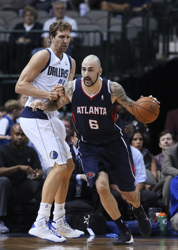 Oct 23, 2013; Dallas, TX, USA; Atlanta Hawks power forward Pero Antic (6) dribbles as Dallas Mavericks power forward Dirk Nowitzki (41) defends during the game at American Airlines Center. Mandatory Credit: Kevin Jairaj-USA TODAY Sports