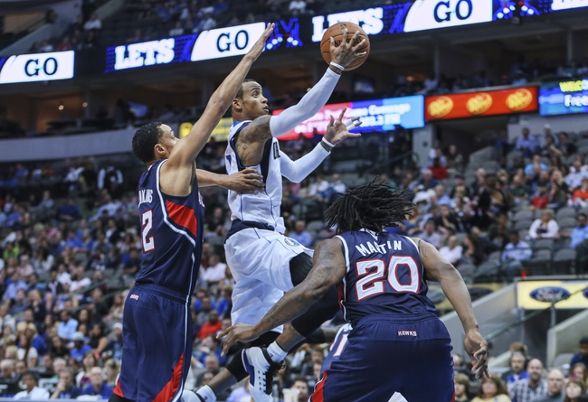 Oct 23, 2013; Dallas, TX, USA;  Dallas Mavericks point guard Monta Ellis (11) shoots past Atlanta Hawks shooting guard John Jenkins (12) during the game at American Airlines Center. Mandatory Credit: Kevin Jairaj-USA TODAY Sports