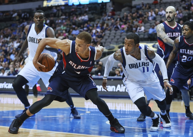 Oct 23, 2013; Dallas, TX, USA; Atlanta Hawks shooting guard Jared Cunningham (7) grabs a loose ball away from Dallas Mavericks point guard Monta Ellis (11) during the game at American Airlines Center. Mandatory Credit: Kevin Jairaj-USA TODAY Sports