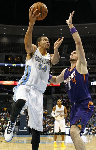 Oct 23, 2013; Denver, CO, USA; Phoenix Suns center Marcin Gortat (4) guards Denver Nuggets center JaVale McGee (34) in the third quarter at the Pepsi Center. The Suns won 98-79. Mandatory Credit: Isaiah J. Downing-USA TODAY Sports