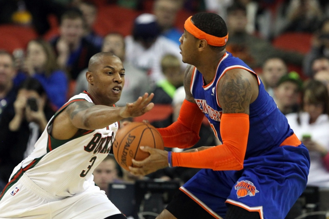 Oct 23, 2013; Green Bay, WI, USA; Milwaukee Bucks forward Caron Butler (3) attempts a steal from New York Knicks forward Carmelo Anthony (7) at the Resch Center in Green Bay.  The Milwaukee Bucks defeated the New York Knicks 105-95. Mandatory Credit: Mary Langenfeld-USA TODAY Sports