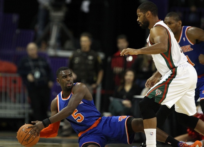 Oct 23, 2013; Green Bay, WI, USA; New York Knicks guard Tim Hardaway Jr. (5) looks to pass as his team plays the Milwaukee Bucks at the Resch Center in Green Bay.  The Milwaukee Bucks defeated the New York Knicks 105-95. Mandatory Credit: Mary Langenfeld-USA TODAY Sports