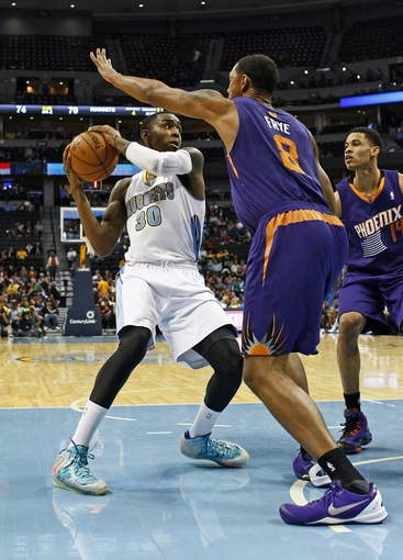 Oct 23, 2013; Denver, CO, USA; Phoenix Suns power forward Channing Frye (8) guards Denver Nuggets small forward Quincy Miller (30) in the third quarter at the Pepsi Center. The Suns won 98-79. Mandatory Credit: Isaiah J. Downing-USA TODAY Sports