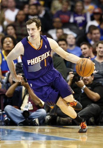 Oct 23, 2013; Denver, CO, USA; Phoenix Suns point guard Goran Dragic (1) controls the ball in the fourth quarter against the Denver Nuggets at the Pepsi Center. The Suns won 98-79. Mandatory Credit: Isaiah J. Downing-USA TODAY Sports