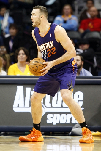 Oct 23, 2013; Denver, CO, USA; Phoenix Suns power forward Miles Plumlee (22) controls the ball in the fourth quarter against the Denver Nuggets at the Pepsi Center. The Suns won 98-79. Mandatory Credit: Isaiah J. Downing-USA TODAY Sports