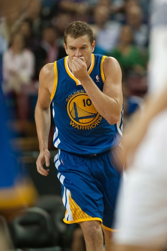 Oct 23, 2013; Sacramento, CA, USA; Golden State Warriors center David Lee (10) reacts after getting hit in the face during the fourth quarter of the game against the Sacramento Kings at Sleep Train Arena. The Sacramento Kings defeated the Golden State Warriors 91-90. Mandatory Credit: Ed Szczepanski-USA TODAY Sports