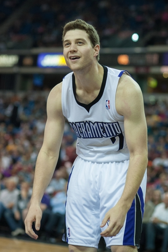 Oct 23, 2013; Sacramento, CA, USA; Sacramento Kings point guard Jimmer Fredette (7) reacts to a call during the fourth quarter of the game against the Golden State Warriors at Sleep Train Arena. The Sacramento Kings defeated the Golden State Warriors 91-90. Mandatory Credit: Ed Szczepanski-USA TODAY Sports