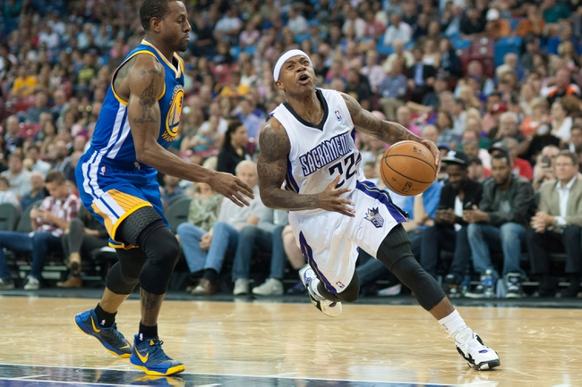 Oct 23, 2013; Sacramento, CA, USA; Sacramento Kings point guard Isaiah Thomas (22) drives to the basket during the fourth quarter against Golden State Warriors shooting guard Andre Iguodala (9) at Sleep Train Arena. The Sacramento Kings defeated the Golden State Warriors 91-90. Mandatory Credit: Ed Szczepanski-USA TODAY Sports
