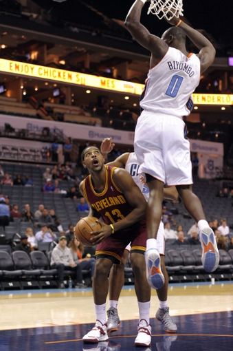 Oct 24, 2013; Charlotte, NC, USA; Cleveland Cavaliers forward center Tristan Thompson (13) looks to shoot as he is blocked by Charlotte Bobcats forward Bismack Biyombo (0) at Time Warner Cable Arena. Mandatory Credit: Sam Sharpe-USA TODAY Sports