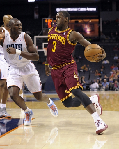 Oct 24, 2013; Charlotte, NC, USA; Cleveland Cavaliers guard Dion Waiters (3) drives past Charlotte Bobcats forward Bismack Biyombo (0) at Time Warner Cable Arena. Mandatory Credit: Sam Sharpe-USA TODAY Sports