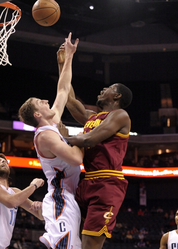Oct 24, 2013; Charlotte, NC, USA; Cleveland Cavaliers forward center Tristan Thompson (13) drives to the basket but is blocked by Charlotte Bobcats forward Cody Zeller (40) during the game at Time Warner Cable Arena. Mandatory Credit: Sam Sharpe-USA TODAY Sports