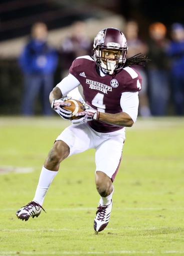 Oct 24, 2013; Starkville, MS, USA; Mississippi State Bulldogs wide receiver Jameon Lewis (4) advances the ball during the game against the Kentucky Wildcats at Davis Wade Stadium. Mandatory Credit: Spruce Derden-USA TODAY Sports