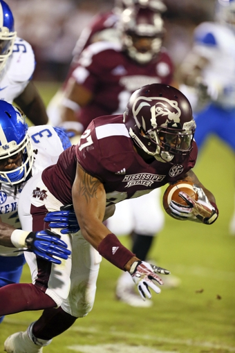 Oct 24, 2013; Starkville, MS, USA; Mississippi State Bulldogs running back LaDarius Perkins (27) advances the ball during the game against the Kentucky Wildcats at Davis Wade Stadium. Mandatory Credit: Spruce Derden-USA TODAY Sports