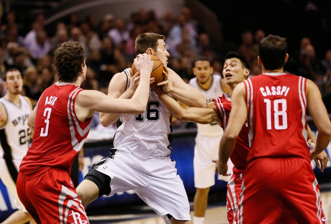 Oct 24, 2013; San Antonio, TX, USA; San Antonio Spurs forward Aron Baynes (16) battle for a rebound with Houston Rockets center Omer Asik (left) and guard Jeremy Lin (right) during the first half at AT&T Center. Mandatory Credit: Soobum Im-USA TODAY Sports