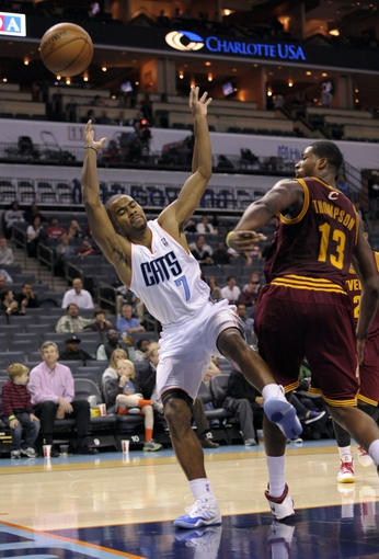 Oct 24, 2013; Charlotte, NC, USA; Charlotte Bobcats guard Ramon Sessions (7) gets fouled by Cleveland Cavaliers forward center Tristan Thompson (13) during the game at Time Warner Cable Arena. Bobcats win 102-95. Mandatory Credit: Sam Sharpe-USA TODAY Sports