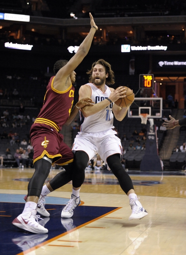 Oct 24, 2013; Charlotte, NC, USA; Charlotte Bobcats forward Josh McRoberts (11) looks to pass against Cleveland Cavaliers guard forward Carrick Felix (30) during the game at Time Warner Cable Arena. Bobcats win 102-95. Mandatory Credit: Sam Sharpe-USA TODAY Sports
