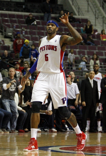 Oct 24, 2013; Auburn Hills, MI, USA; Detroit Pistons small forward Josh Smith (6) makes a game winning shot as time expires against the Minnesota Timberwolves at The Palace of Auburn Hills. Pistons beat the Timberwolves 99-98. Mandatory Credit: Raj Mehta-USA TODAY Sports