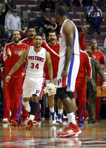Oct 24, 2013; Auburn Hills, MI, USA; Detroit Pistons point guard Peyton Siva (34) and teammates rush towards small forward Josh Smith (6) after his game winning three point basket against the Minnesota Timberwolves as time expires at The Palace of Auburn Hills. Pistons beat the Timberwolves 99-98. Mandatory Credit: Raj Mehta-USA TODAY Sports