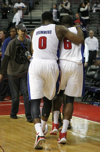 Oct 24, 2013; Auburn Hills, MI, USA; Detroit Pistons center Andre Drummond (0) hugs small forward Josh Smith (6) after the game against the Minnesota Timberwolves at The Palace of Auburn Hills. Pistons beat the Timberwolves 99-98. Mandatory Credit: Raj Mehta-USA TODAY Sports