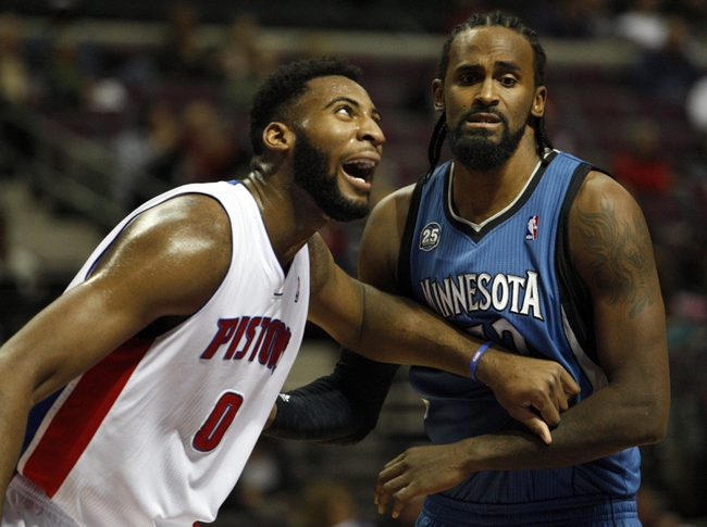 Oct 24, 2013; Auburn Hills, MI, USA; Detroit Pistons center Andre Drummond (0) fights for position against Minnesota Timberwolves center Ronny Turiaf (32) during the second quarter at The Palace of Auburn Hills. Mandatory Credit: Raj Mehta-USA TODAY Sports