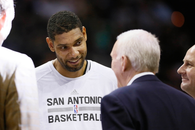 Oct 24, 2013; San Antonio, TX, USA; San Antonio Spurs forward Tim Duncan (21) shares a laugh with head coach Gregg Popovich during the second half at AT&T Center. The Rockets won 109-92. Mandatory Credit: Soobum Im-USA TODAY Sports