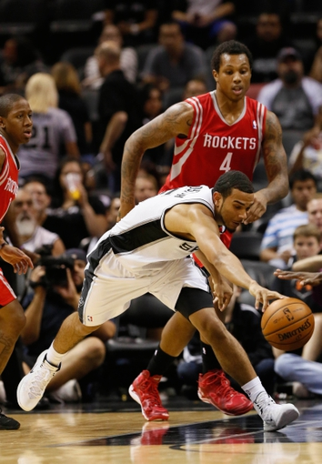 Oct 24, 2013; San Antonio, TX, USA; San Antonio Spurs guard Cory Joseph (5) battles for a loose ball against the Houston Rockets during the second half at AT&T Center. The Rockets won 109-92. Mandatory Credit: Soobum Im-USA TODAY Sports