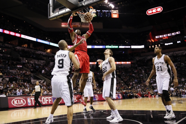 Oct 24, 2013; San Antonio, TX, USA; Houston Rockets center Dwight Howard (12) dunks during the second half against the San Antonio Spurs at AT&T Center. The Rockets won 109-92. Mandatory Credit: Soobum Im-USA TODAY Sports