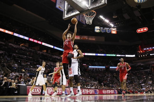 Oct 24, 2013; San Antonio, TX, USA; Houston Rockets forward Chandler Parsons (25) drives to the basket past San Antonio Spurs forward Tim Duncan (21) during the second half at AT&T Center. The Rockets won 109-92. Mandatory Credit: Soobum Im-USA TODAY Sports